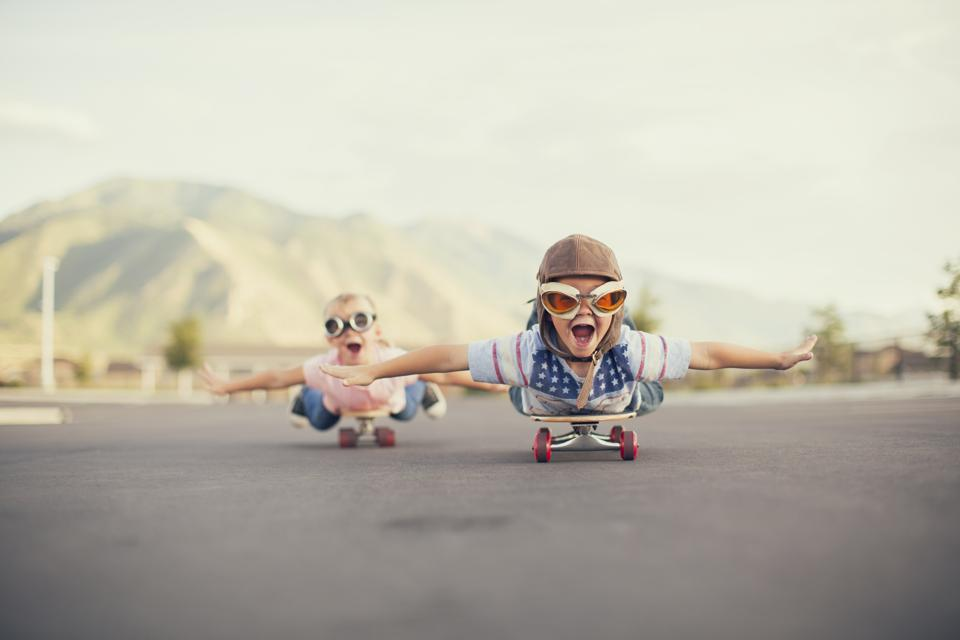 Kids imagine flying on skateboard, capturing the idea that play helps us to imagine.